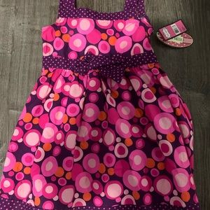 2 dresses very colorful. Brand new